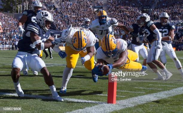 Dade Dietrich of the McNeese State Cowboys tries to extend into the end zone with help from teammate Lawayne Ross as Michael Shelton of the BYU...