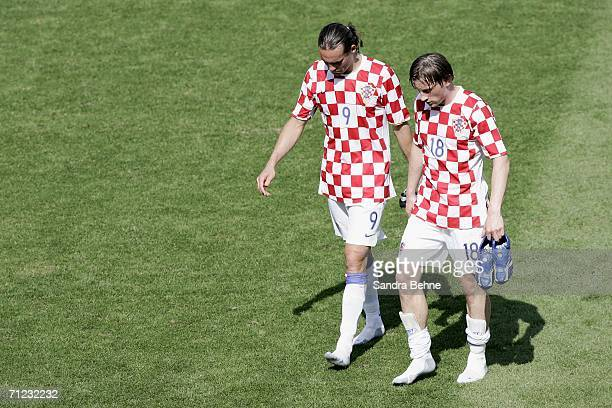 Dado Prso and Ivica Olic of Croatia walk off the pitch following their team's 00 draw during the FIFA World Cup Germany 2006 Group F match between...