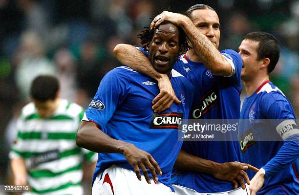 Dado Prso embraces Ugo Ehiogu of Rangers at the end of the Scottish Premier League match between Celtic and Rangers at Celtic Park on March 11 2007...
