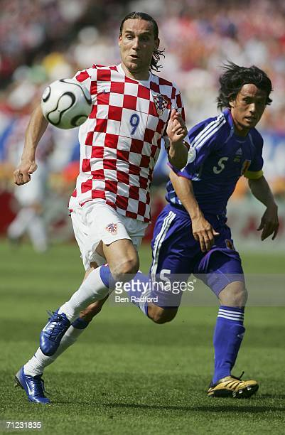 Dado Prso of Croatia and Tsuneyasu Miyamoto of Japan chase the ball during the FIFA World Cup Germany 2006 Group F match between Japan and Croatia at...