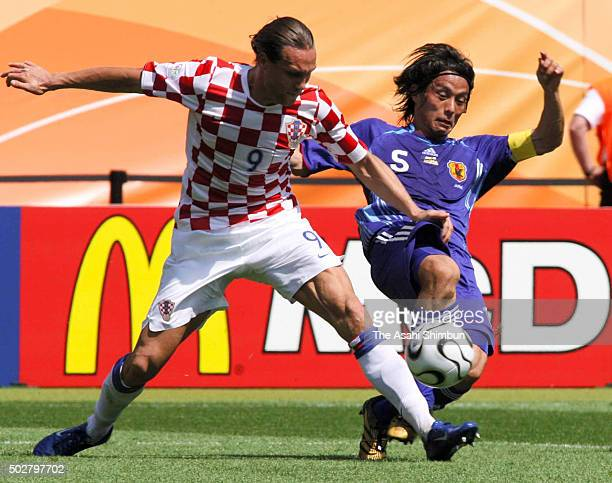 Dado Prso of Croatia and Tsuneyasu Miyamoto of Japan compete for the ball during the FIFA World Cup Germany 2006 Group F match between Japan and...