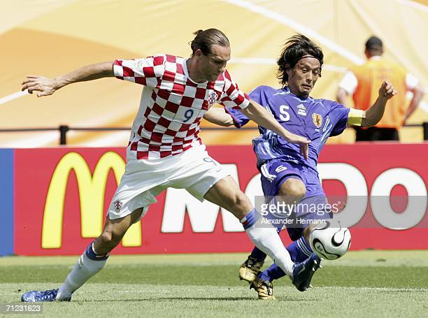 Dado Prso of Croatia battles for the ball with Tsuneyasu Miyamoto of Japan during the FIFA World Cup Germany 2006 Group F match between Japan and...