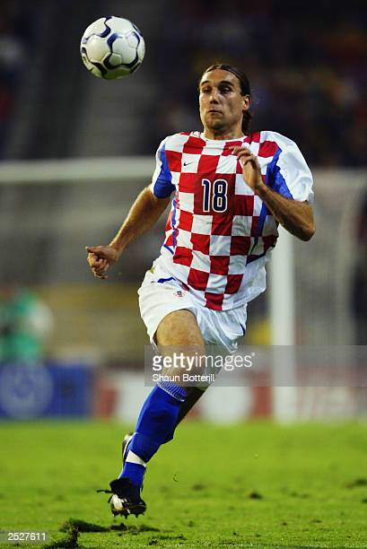 Dado Prso of Croatia charges forward during the UEFA European Championships 2004 Group 8 Qualifying match between Belgium and Croatia held on...
