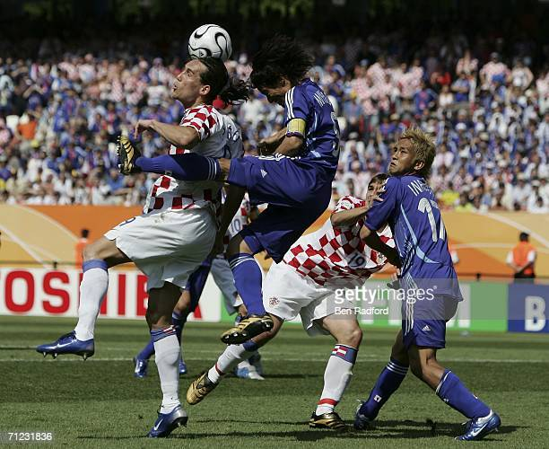Dado Prso of Croatia competes for the ball with Tsuneyasu Miyamoto of Japan during the FIFA World Cup Germany 2006 Group F match between Japan and...