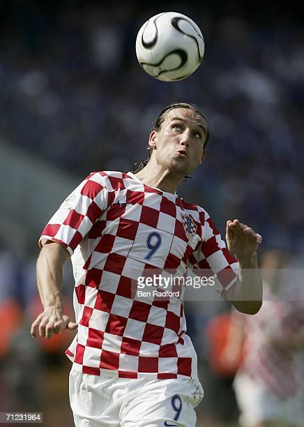Dado Prso of Croatia heads the ball during the FIFA World Cup Germany 2006 Group F match between Japan and Croatia at the Frankenstadion on June 18...