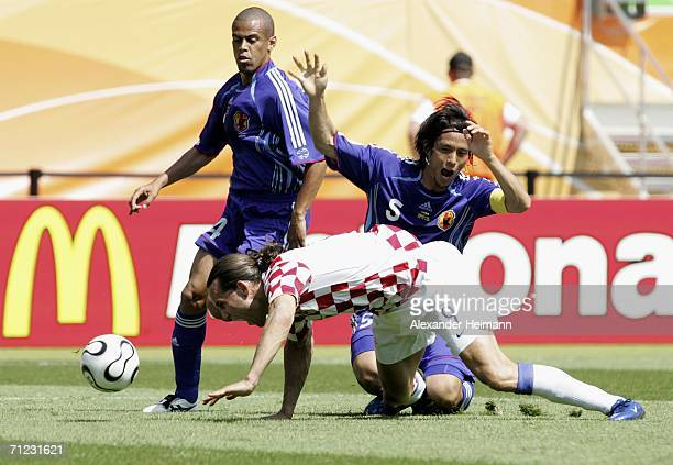 Dado Prso of Croatia is brought down in the area by Tsuneyasu Miyamoto of Japan to win his team a penalty during the FIFA World Cup Germany 2006...