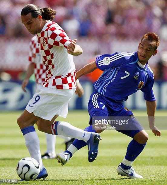 Dado Prso of Croatia is challenged by Hidetoshi Nakata of Japan during the FIFA World Cup Germany 2006 Group F match between Japan and Croatia at the...