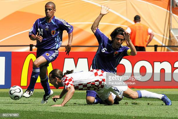 Dado Prso of Croatia is fouled by Tsuneyasu Miyamoto of Japan resulting in the penalty during the FIFA World Cup Germany 2006 Group F match between...