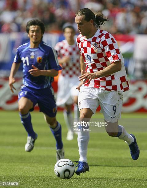 Dado Prso of Croatia runs with the ball during the FIFA World Cup Germany 2006 Group F match between Japan and Croatia at the Frankenstadion on June...