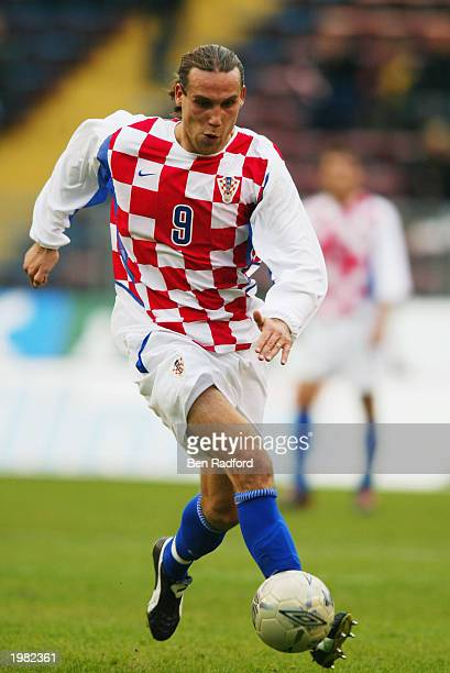 Dado Prso of Croatia runs with the ball during the International Friendly match between Sweden and Croatia held on April 30 2003 at the Rasunda...