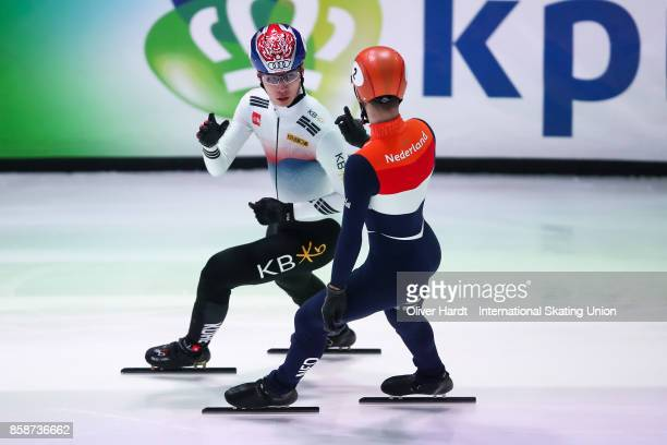 Dae Heon Hwang of Korea and Sjinkie Knegt of Netherlands competes in the Mens 1500m semi finals race during the Audi ISU World Cup Short Track Speed...