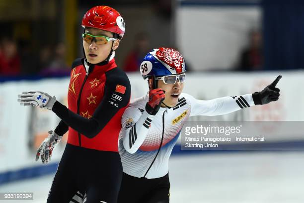 Dae Heon Hwang of Korea celebrates as he finishes ahead of Ziwei Ren of China in the men's 500 meter Final during the World Short Track Speed Skating...