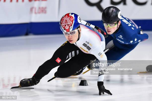 Dae Heon Hwang of Korea competes against JohnHenry Krueger of the USA in the men's 1500 meter heats during the World Short Track Speed Skating...