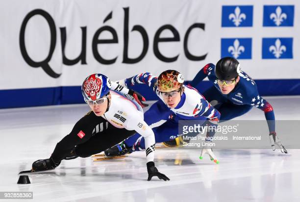 Dae Heon Hwang of Korea competes against Semen Elistratov of Russia and JohnHenry Krueger of the USA during the World Short Track Speed Skating...