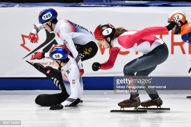 Dae Heon Hwang of Korea falls in front of teammate Hyo Jun Lim of Korea and Samuel Girard of Canada in the men's 1000 meter Final during the World...