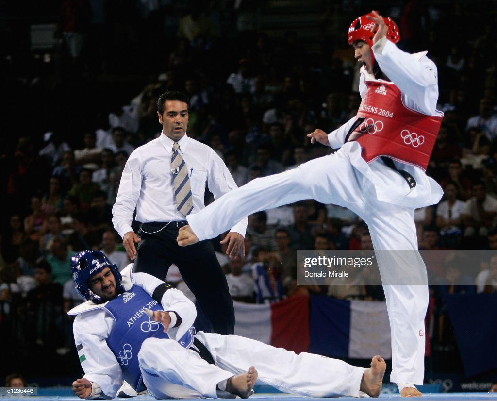 Dae Sung Moon of Korea competes against Jon Garcia of Spain in the men's over 80 kg Taekwondo quarterifinall match on August 29, 2004 during the Athens 2004 Summer Olympic Games at the Sports Pavilion part of the Faliro Coastal Zone Olympic Complex.