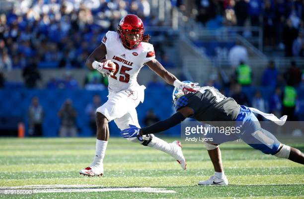 Dae Williams of the Louisville Cardinals runs with the ball against the Kentucky Wildcats during the game at Commonwealth Stadium on November 25 2017...