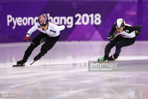 Daeheon Hwang of Korea and Keita Watanabe of Japan skate during their Men's 500m Short Track Speed Skating Quarter Final on day thirteen of the...