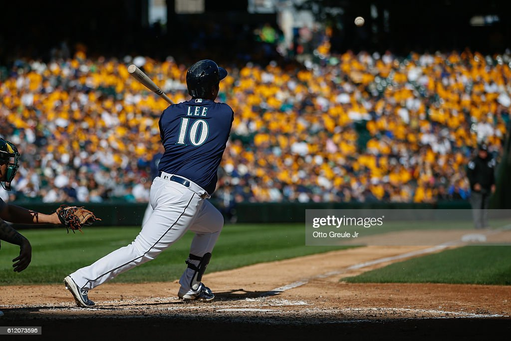 Dae-Ho Lee #10 of the Seattle Mariners singles in the fifth inning against the Oakland Athletics at Safeco Field on October 2, 2016 in Seattle, Washington. The Athletics defeated the Mariners 3-2.