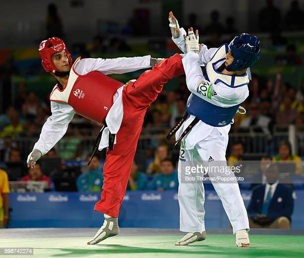 Daehoon Lee of Korea competes against Ahmad Abughaush of Jordan during their 68Kg Quarterfinal Taekwondo contest at the Carioca Arena on Day 13 of...