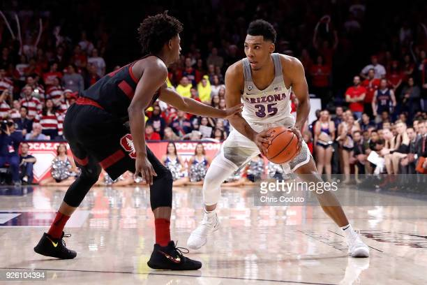 Daejon Davis of the Stanford Cardinal defends Allonzo Trier of the Arizona Wildcats during the second half of the college basketball game at McKale...