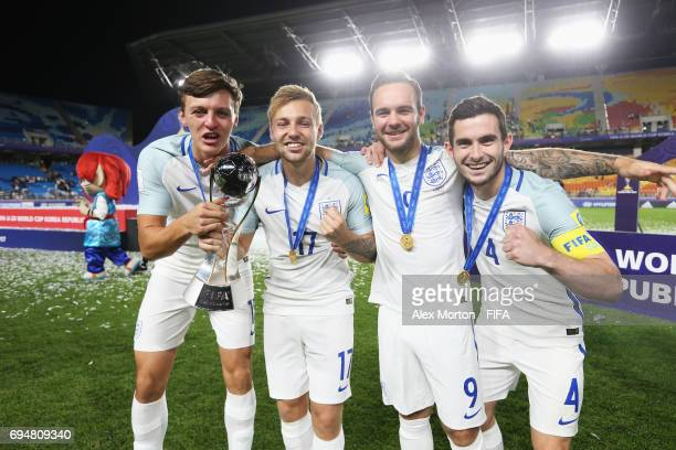 Dael Fry Harrison Chapman Adam Armstrong and Lewis Cook of England celebrate victory with the trophy after the FIFA U20 World Cup Korea Republic 2017...