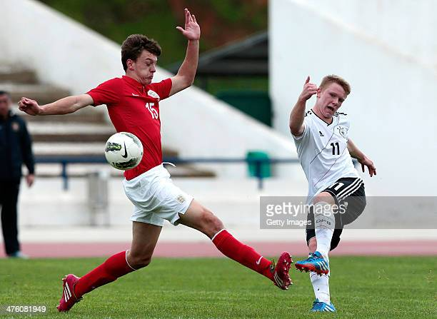 Dael Fry of England challenges Philipp Ochs of Germany during the Under17 Algarve Cup between U17 England and U17 Germany at Lagos sport complex on...