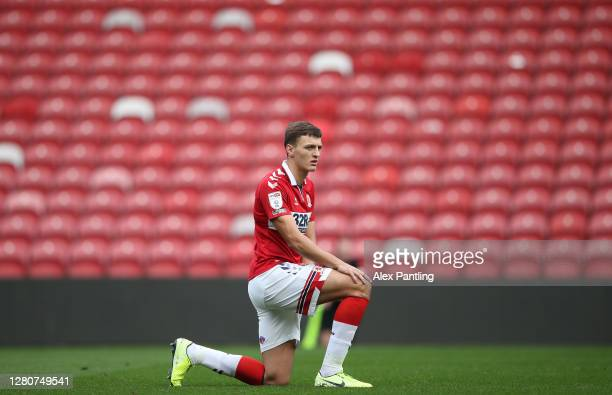 Dael Fry of Middlesborough takes a knee prior to the Sky Bet Championship match between Middlesbrough and Reading at Riverside Stadium on October 17...