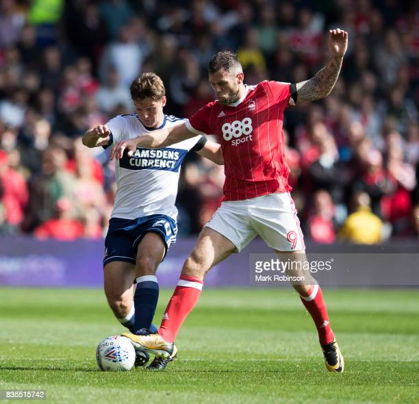 Dael Fry of Middlesbrough and Daryl Murphy of Nottingham Forest during the Sky Bet Championship match between Nottingham Forest and Middlesbrough at...