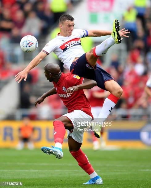 Dael Fry of Middlesbrough competes with Benik Afobe of Bristol City during the Sky Bet Championship match between Bristol City and Middlesbrough at...