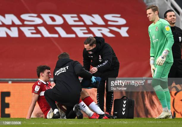 Dael Fry of Middlesbrough is seen with blood on his face as he receives medical treatment during the Sky Bet Championship match between Middlesbrough...