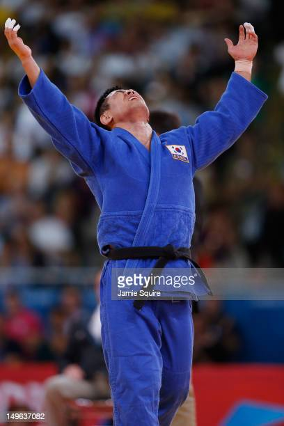DaeNam Song of Korea celebrates winning the gold medal during the Men's 90 kg Judo on Day 5 of the London 2012 Olympic Games at ExCeL on August 1...