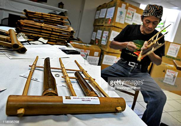 Daeng Udjo center maestro of the Indonesian musical instrument called the angklung works on getting thousands of them in tune for the mass concert...