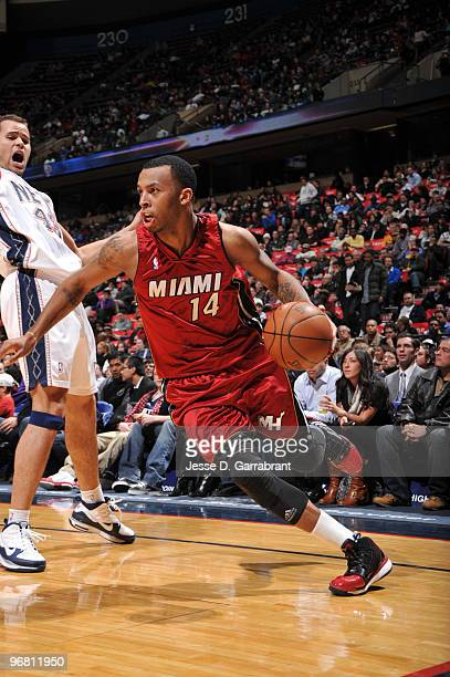 Daequan Cook of the Miami Heat drives against the New Jersey Nets during the game on February 17 2010 at the Izod Center in East Rutherford New...