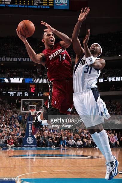 Daequan Cook of the Miami Heat goes up for the layup against Jason Terry of the Dallas Mavericks during a game at the American Airlines Center on...