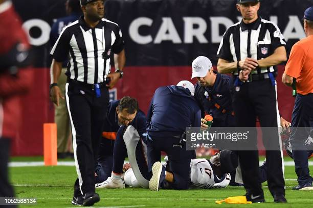 DaeSean Hamilton of the Denver Broncos is shaken up in the first half against the Arizona Cardinals at State Farm Stadium on October 18 2018 in...