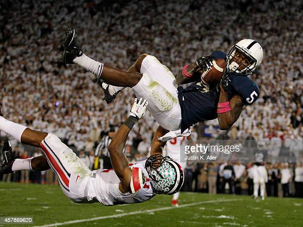 DaeSean Hamilton of the Penn State Nittany Lions catches a 12 yard pass in overtime against Vonn Bell of the Ohio State Buckeyes during the game on...
