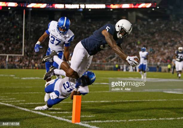 DaeSean Hamilton of the Penn State Nittany Lions dives for the endzone scoring a 27 yard touchdown in the first half against Antreal Allen and Victor...