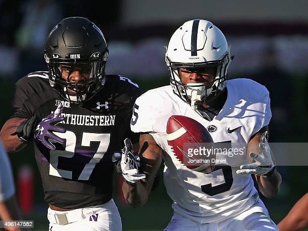 DaeSean Hamilton of the Penn State Nittany Lions fumbles the ball on the last play of the game under pressure from Matthew Harris of the Northwestern...