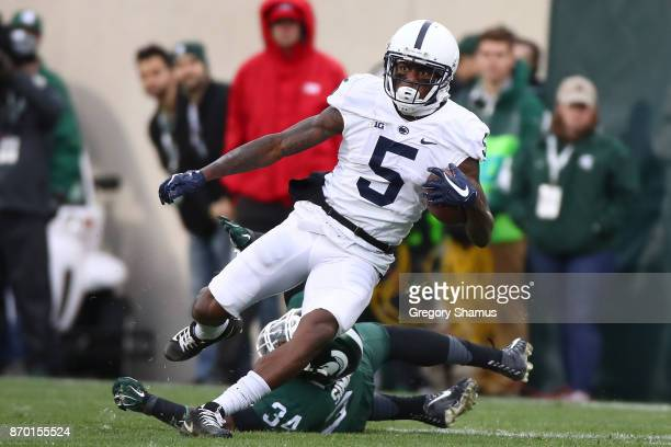 DaeSean Hamilton of the Penn State Nittany Lions gets around Antjuan Simmons of the Michigan State Spartans during the first half at Spartan Stadium...