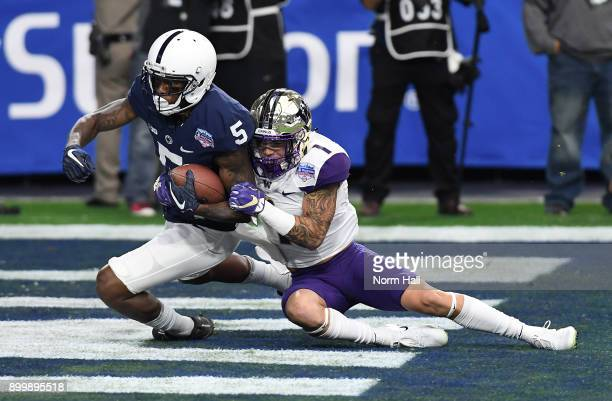 DaeSean Hamilton of the Penn State Nittany Lions scores a touchdown on a 48 yard reception during the first quarter while being tackled in the...