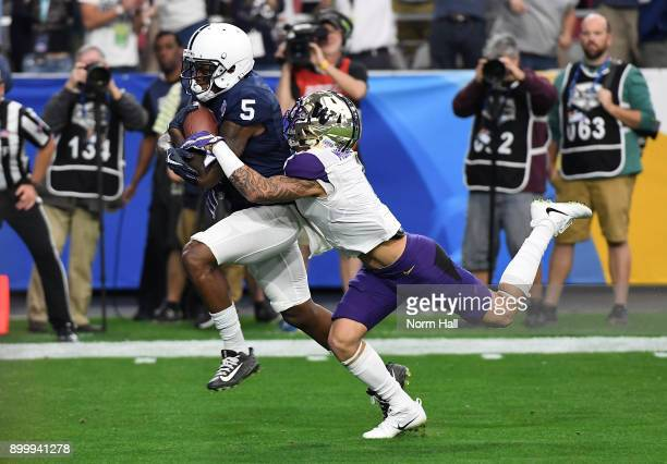DaeSean Hamilton of the Penn State Nittany Lions scores a touchdown on a 48 yard reception during the first quarter while dragging Byron Murphy of...