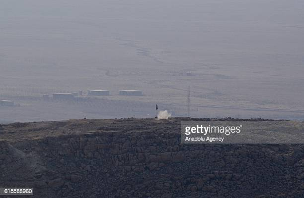 Daesh terrorists' socolled flag is seen at Bashiqa town during the operation to retake Iraq's Mosul from Daesh in Mosul Iraq on October 19 2016 A...