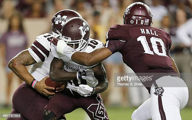 Daeshon Hall of the Texas AM Aggies runs over Brandon Holloway of the Mississippi State Bulldogs to tackle Dak Prescott in the second quarter on...