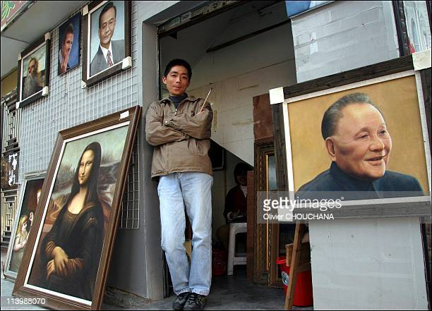 Dafen oil painting village in the South of China in January 2007A painter poses in front of his shop at Dafen oil painting village near the city of...