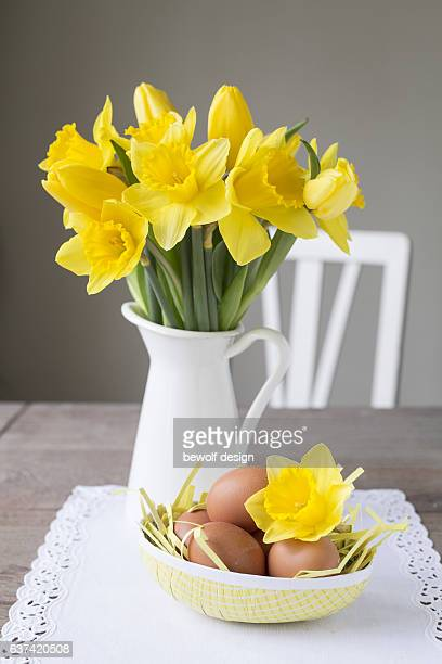 daffodils in a jug - easter decoration - easter flowers stock pictures, royalty-free photos & images