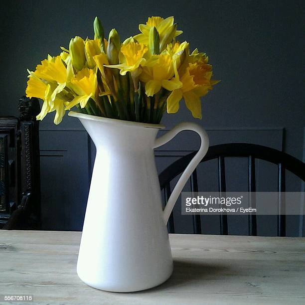 Daffodils In White Vase On Table