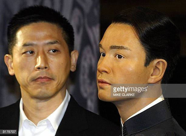Daffy Tong partner of Entertainer Leslie Cheung looks at his waxwork unveiled at Madame Tussaud waxworks in Hong Kong 31 March 2004 Leslie Cheung one...