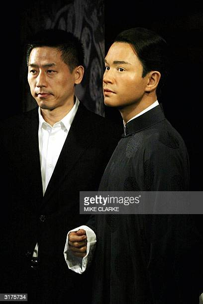 Daffy Tong partner of Entertainer Leslie Cheung looks on at Cheung's waxwork bein unveiled at Madame Tussaud waxworks in Hong Kong 31 March 2004...