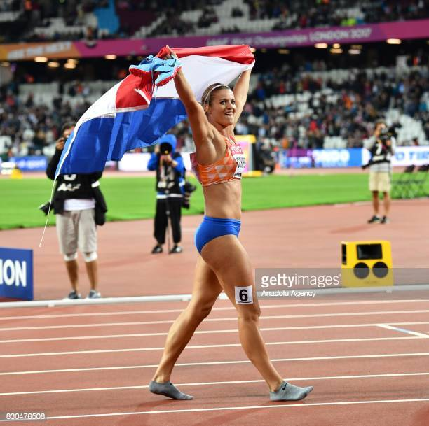 Dafne Schippers of Netherlands celebrates her first place in the Women's 200m final during the 'IAAF Athletics World Championships London 2017' at...